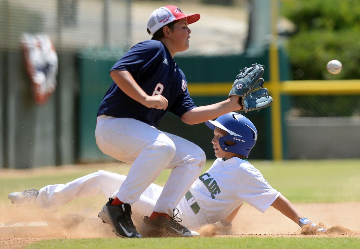 Cascade Little League's Isaac Hodory slides into third base ahead of the tag during the sixth inning of the Northwest Regional semifinal Friday in San Bernardino, Calif. Cascade lost to Wilshire-Riverside of Portland 10-6.