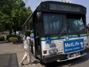 C-Tran's Route 39 bus stops for a passenger on East Fourth Plain Boulevard  on Aug.