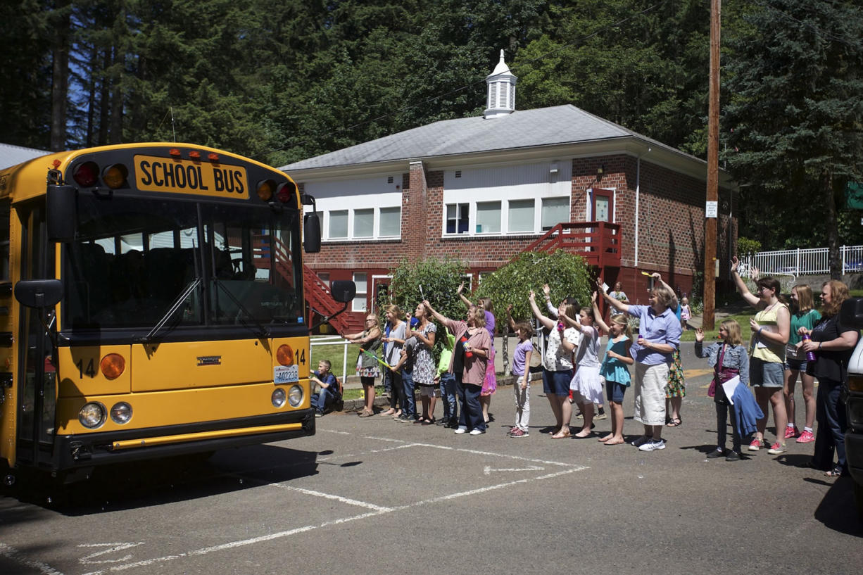 On the last day of the school year at Green Mountain School, staff members blow bubbles and wave goodbye to students on departing buses. Green Mountain School and schools in La Center were the first Clark County districts to release for summer vacation Wednesday.