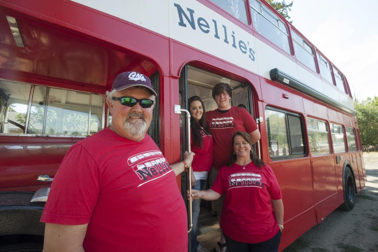 David Sale, left, and his daughter, Kayla; son, Joshua; and wife, Jeannette, restored a double-decker bus and transformed it into a food cart.