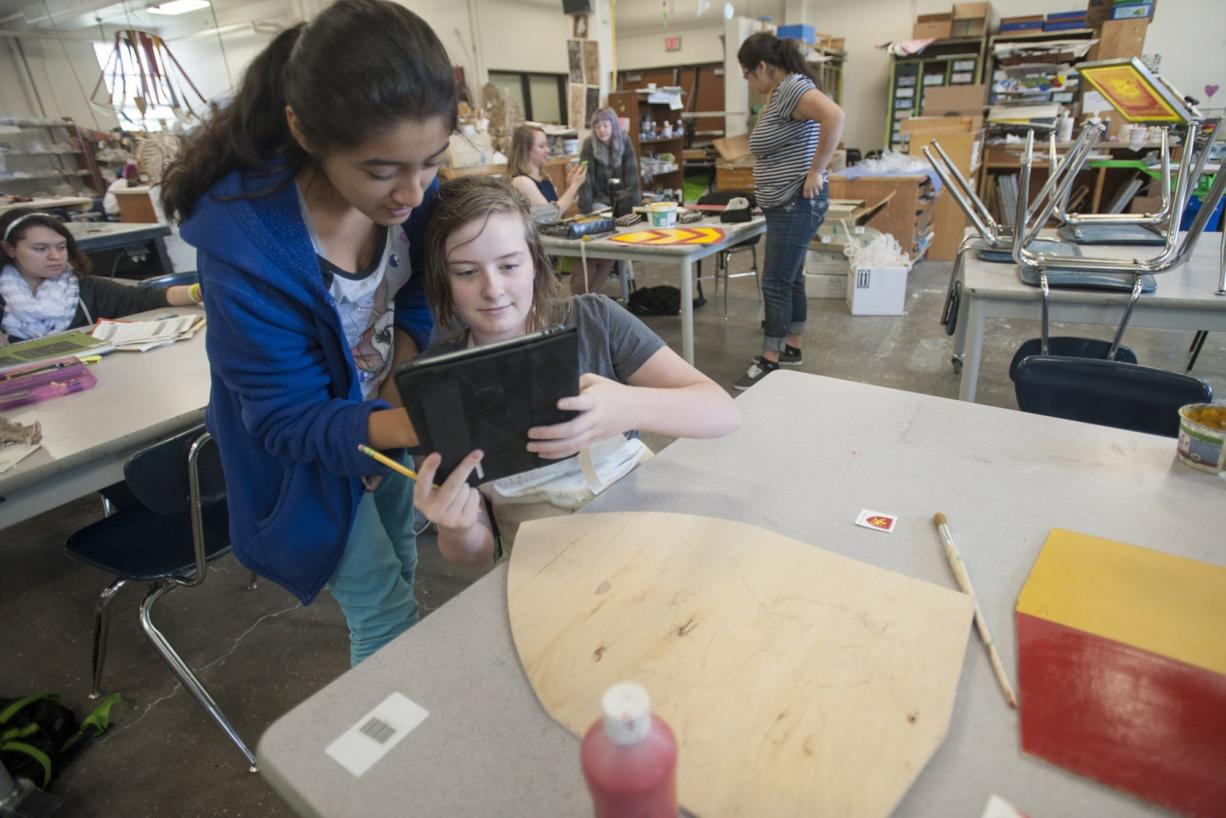 Savanna Falkner, a student at Vancouver School of Arts and Academics, uses an iPad earlier this month to show a classmate how she will paint a shield representing William de Lanvallei, an English baron during the 13th century.