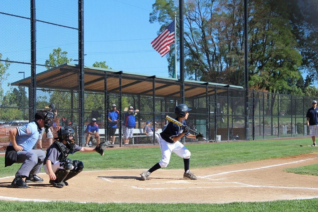 My Grandson Alex Miller playing baseball.  Feels very American,