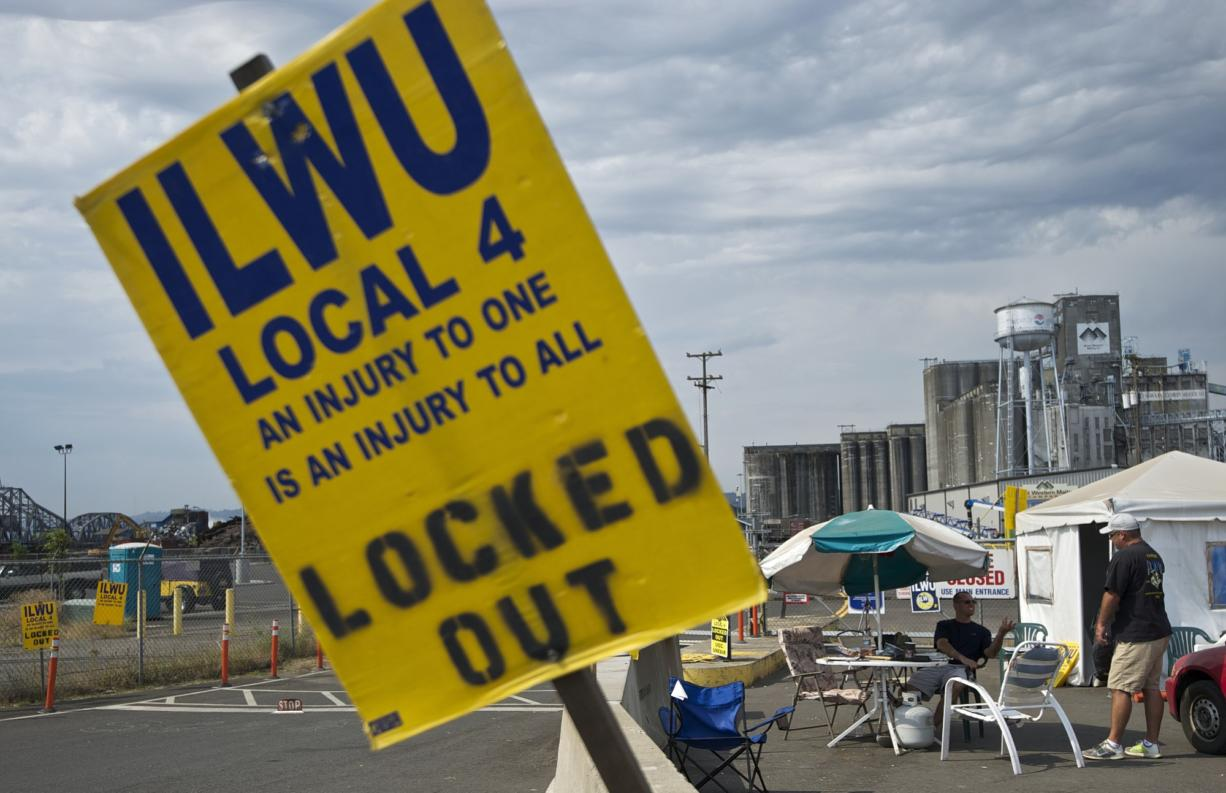 ILWU Local 4 members remain outside the United Grain terminal, on Tuesday, after word of a tentative agreement has surfaced.