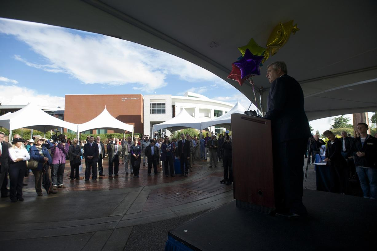 Clark College President Bob Knight reveals the amount of money raised during a five-year fundraiser in a ceremony Tuesday at the college. The goal was to raise $20 million, but the final sum was $26,593,789.