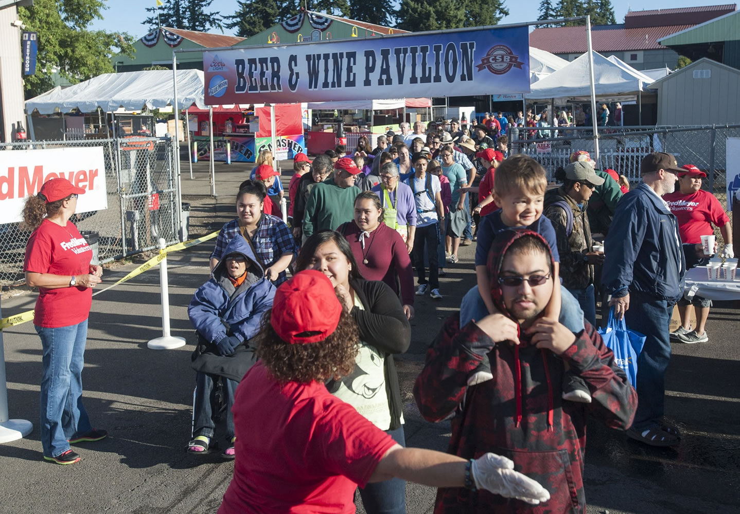 Throngs of people line up for free pancakes at the Clark County Fairgrounds in Vancouver Friday. The annual event, signals the kick off of the Clark County Fair which starts today and continues until August 16.
