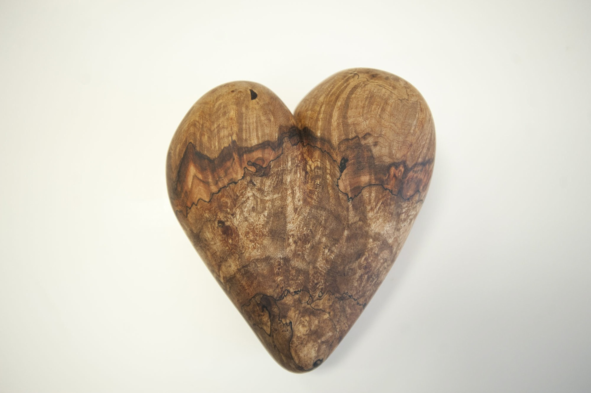 Max McBurnett crafted a wooden heart from an old maple burl.