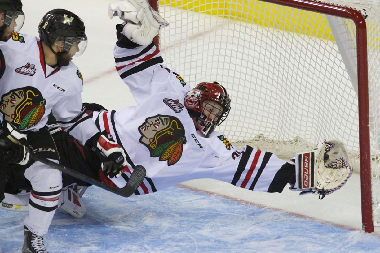 Portland goaltender Adin Hill makes a save that is later ruled a goal as the Portland Winterhawks take on the Kelowna Rockets at the Moda Center, Tuesday, April 28, 2015.