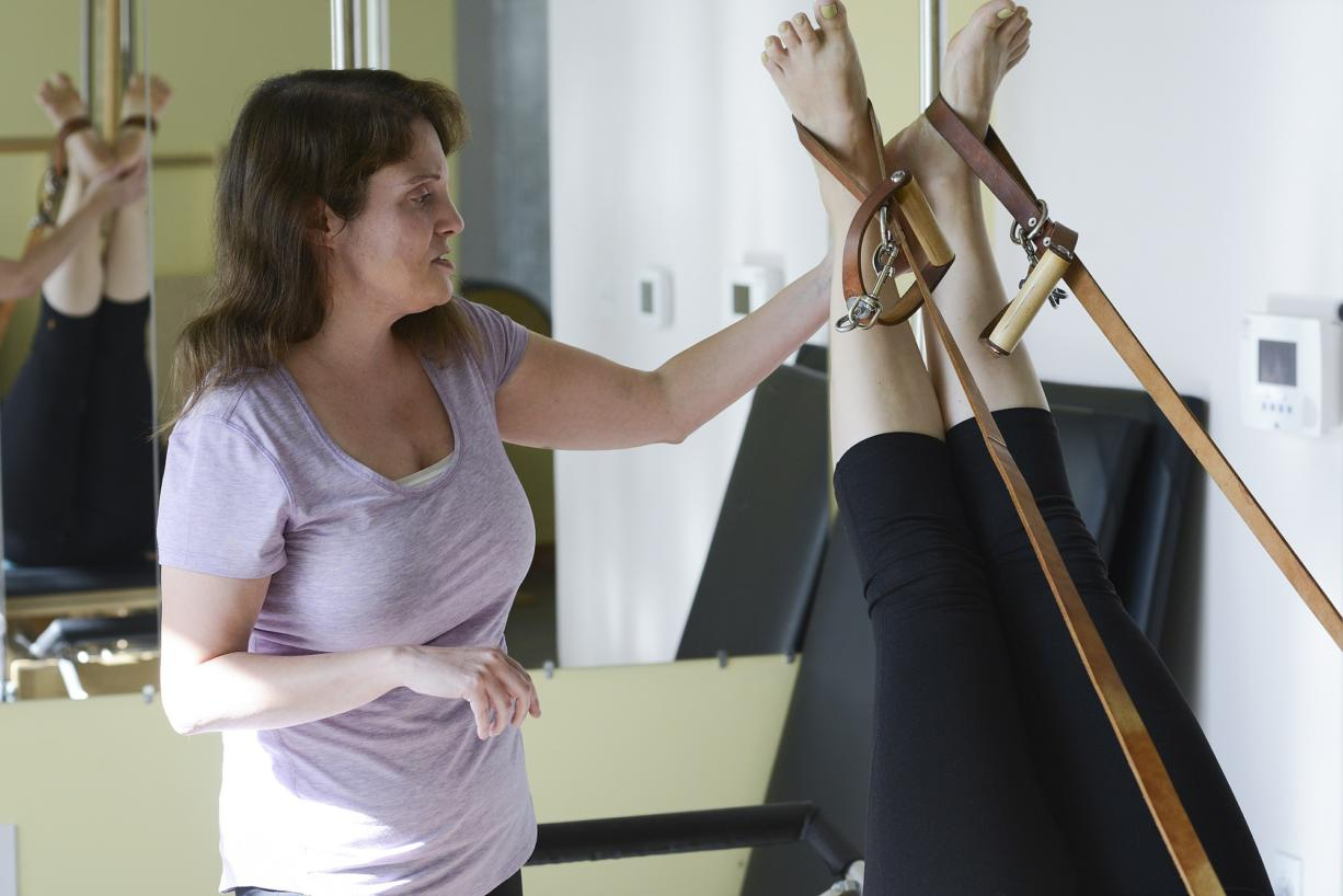 Ariane Kunze/The Columbian Laura Kotsovos of Camas practices teaching Pilates to her instructor Jessica Schultz during a lesson Tuesday at Jessica Schultz Pilates in Portland. Kotsovos, 39, was diagnosed with cerebral palsy as an infant and is now training to be a Pilates instructor