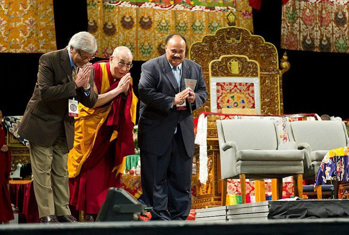 Arun Gandhi, from left, prays with the Dalai Lama and Martin Luther King III, son of the Rev. Dr.
