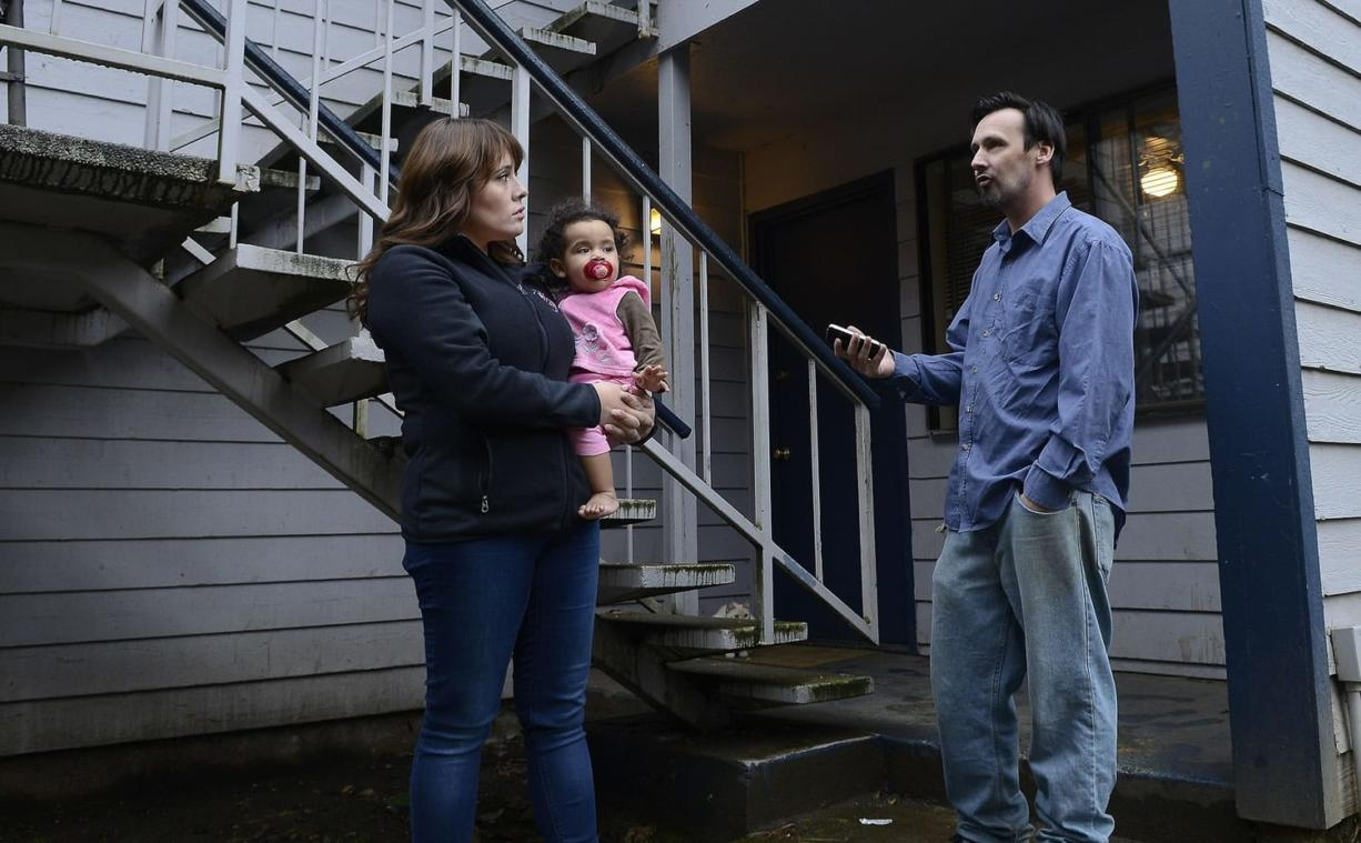 Natalia Mosley, holding onto daughter Isabel, chats with neighbor Kevin Giard about the upheaval at Courtyard Village Apartments, where new owners have begun notifying residents that they'll need to leave because of pending renovations and rises in rent.