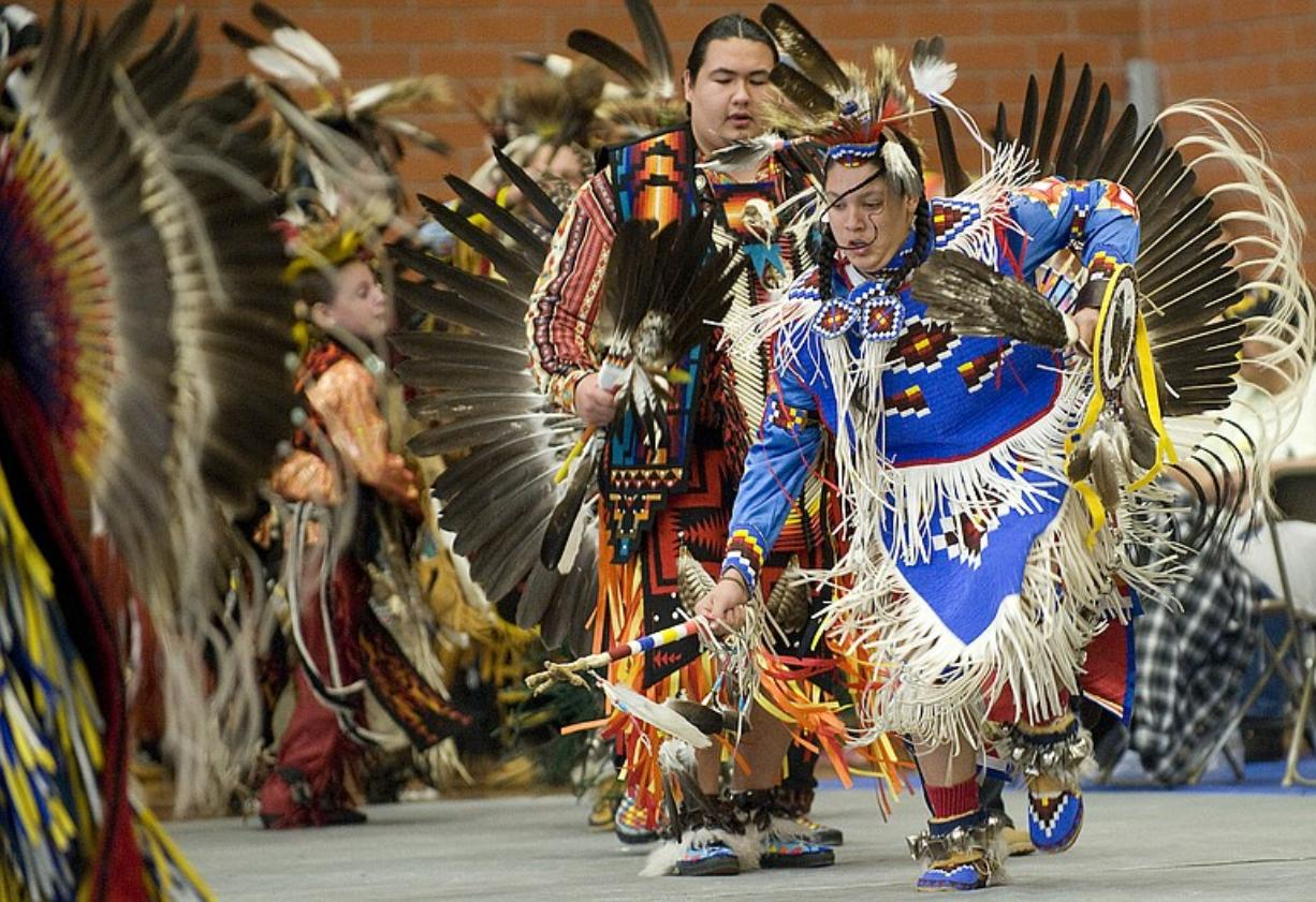 Koda-Wataka Robinson, 15, front, of Camas dances Saturday during the Grand Entry at a traditional powwow.