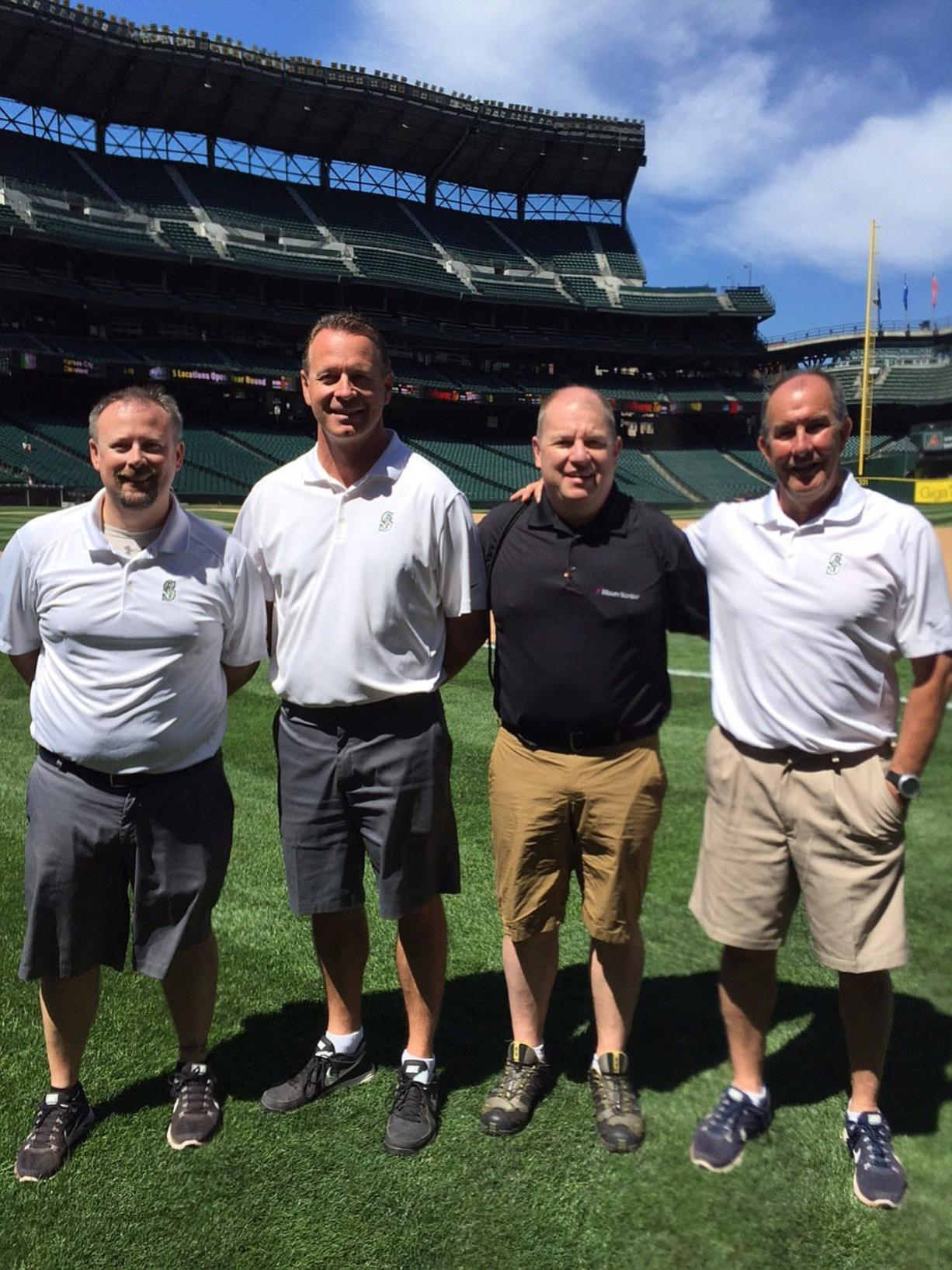 East Vancouver: Brian Apling, black shirt, joined trainers from the Seattle Mariners at Safeco Field on July 28 to talk to children as part of Professional Baseball Athletic Trainers Society's PLAY Campaign.