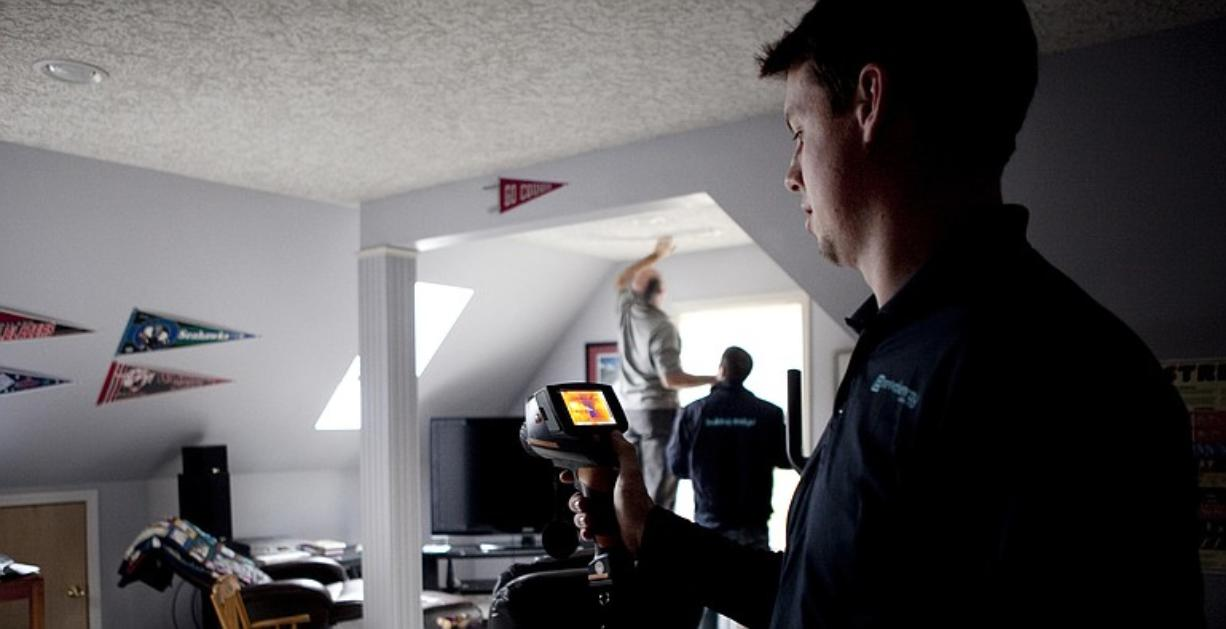 Robert Brierley, owner of Vancouver-based Revival Energy Group, tests a room for cold-air leaks at a home in Vancouver. Brierley's company has reinvented itself to perform energy audits of homes and offices with the aim of helping owners cut energy costs and save money.
