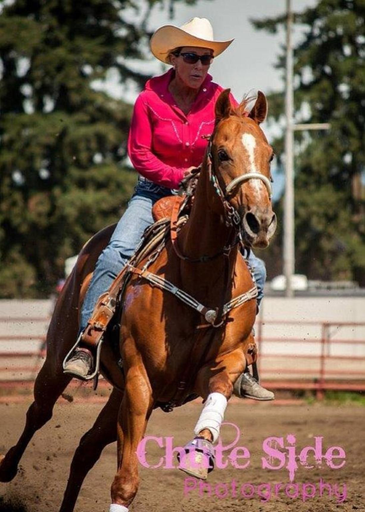 Orchards: Tina Olson, founder of The Chopper Fund, and her horse Dash at the Chasin' For Chopper barrel racing event to raise money for major medical expenses for shelter animals.