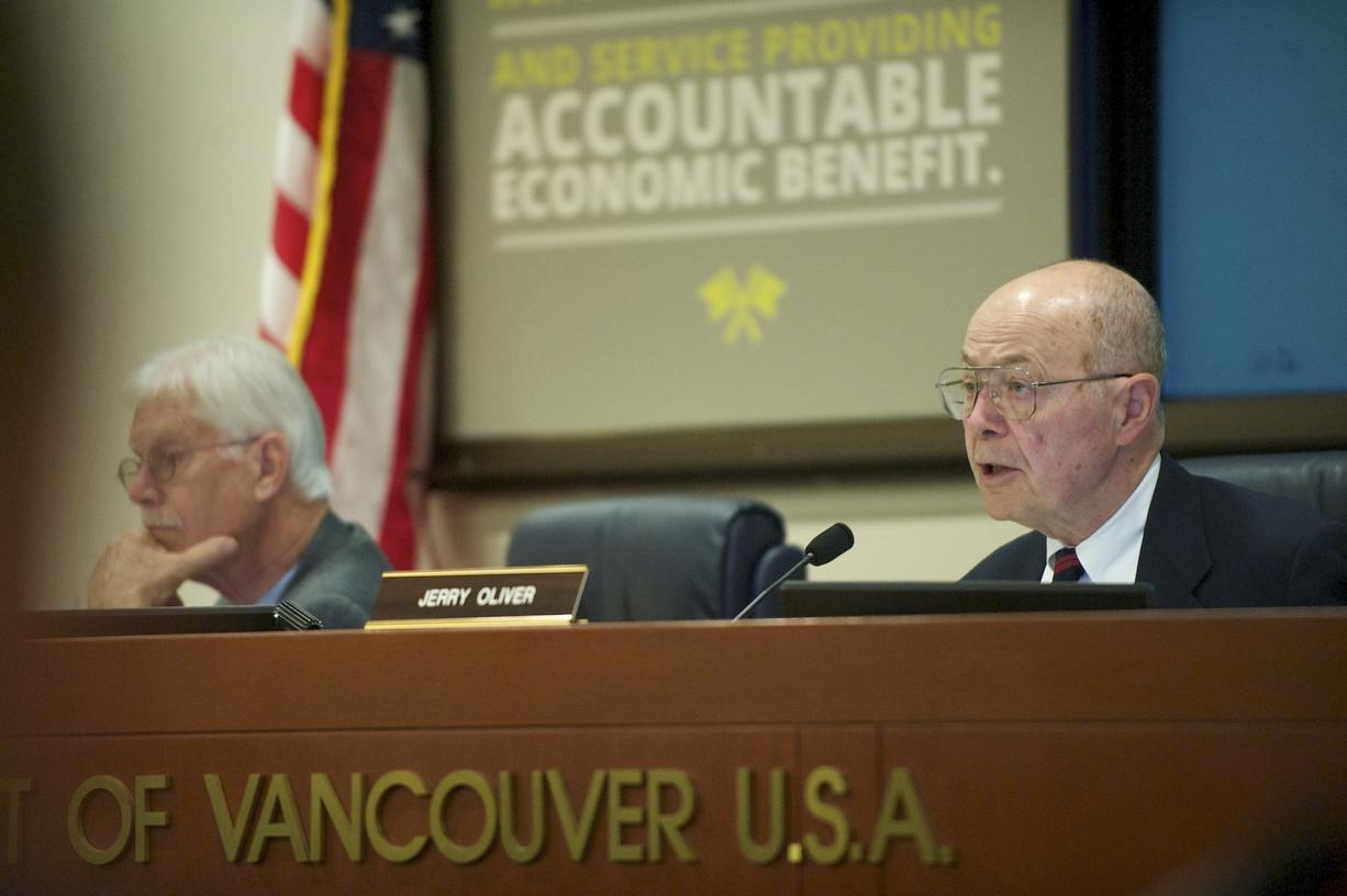 A Vancouver resident has filed two petitions with the Clark County elections office seeking to recall from office Port of Vancouver commissioners Jerry Oliver, right, and Brian Wolfe.