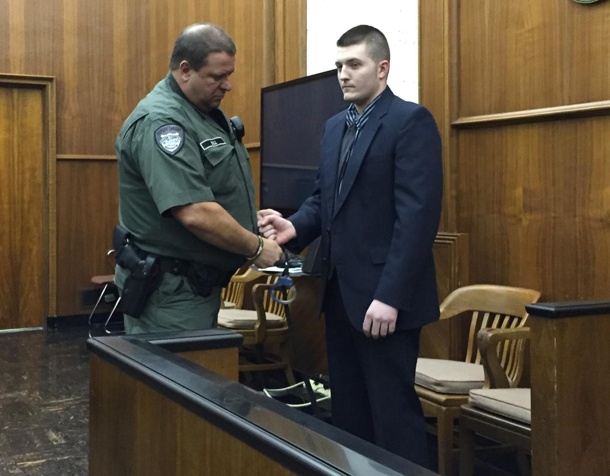 Jarrod Wiebe, 27, of Snohomish is escorted out of Clark County Superior Court Judge Scott Collier's courtroom after a jury found him guilty of 16 felony charges related to a home-invasion robbery in Ridgefield in December.