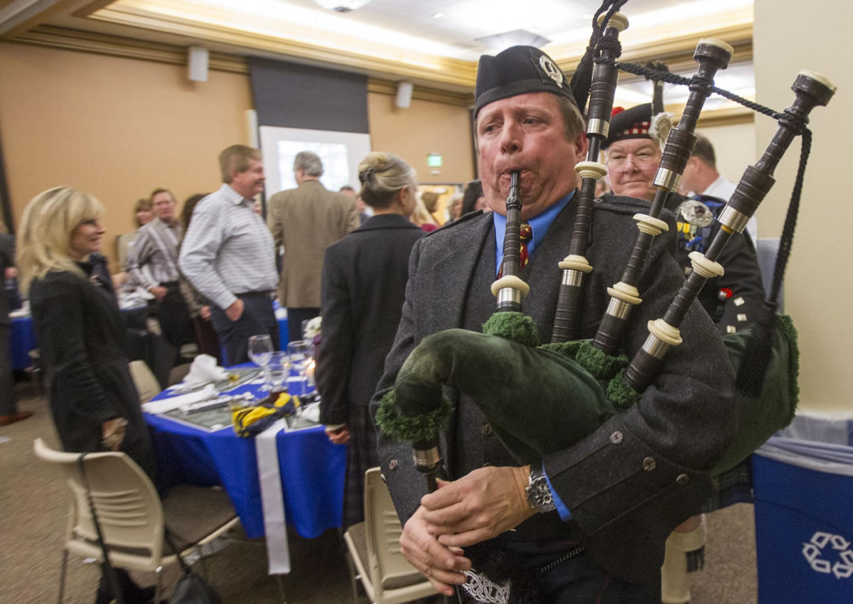 Timothy Gunn plays bagpipes to welcome in the haggis at the inaugural Robert Burns Dinner at Clark College. The Thursday evening Scottish supper raised money for a student from Scotland to attend Clark College.