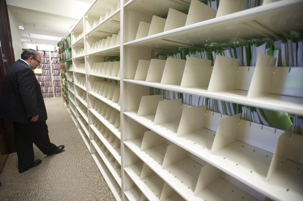 Clark County Clerk Scott Weber walks through an aisle of empty shelves where civil and domestic law case files were filed before the clerk's office went digital.