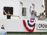 Nancy Curcio, left, celebrates Saturday immediately after christening Crown Point -- the newest towboat of Tidewater Transportation and Terminals -- at Vancouver's Terminal 1 along the Columbia River.