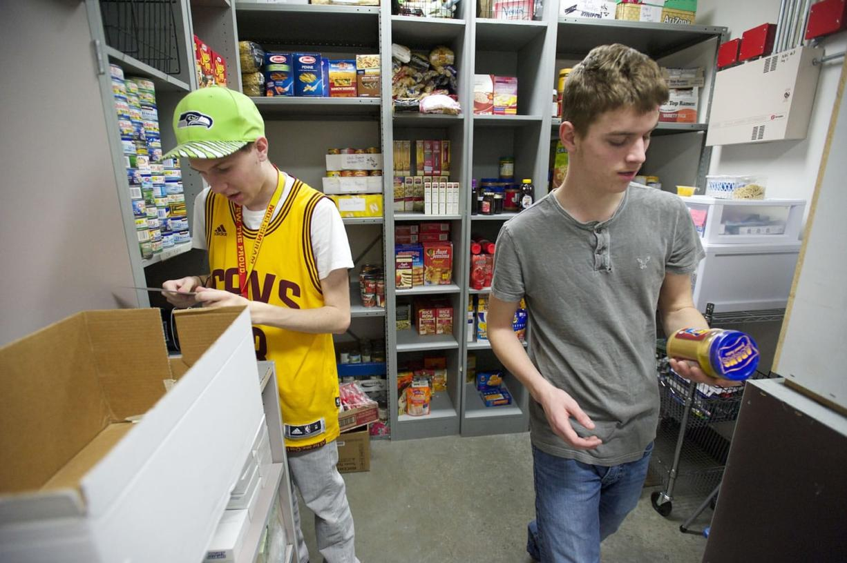 Skyview High School students Preston Manor, 17, left, and Nick Mcinnis, 17, prepare an anonymous student's order from the school's Care Closet on Tuesday.