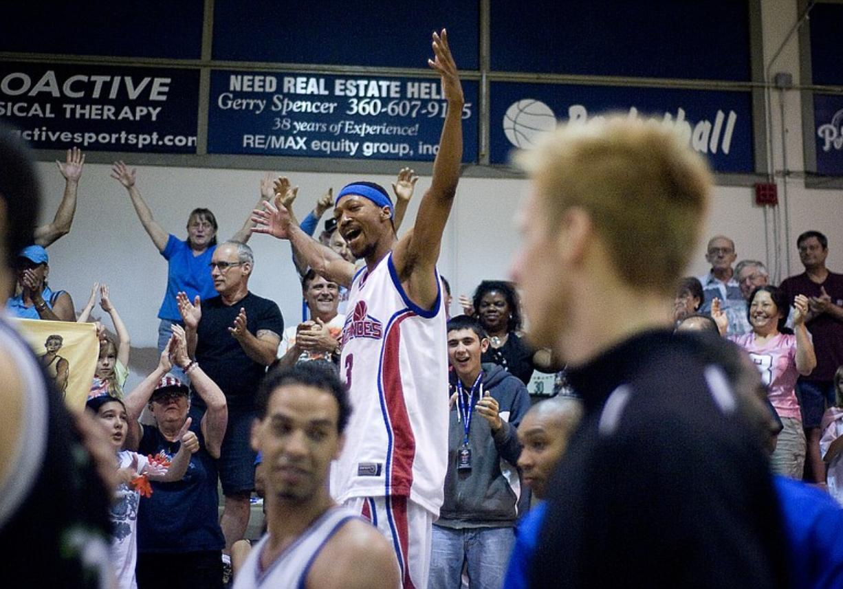 Volcanoes forward Kevin Bloodsaw celebrates in the stands after winning the IBL championship game against the Edmonton Energy 124-116 at the O'Connell Sports Center at Clark College on Sunday.