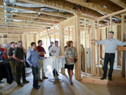 Ariane Kunze/The Columbian Mark LaLiberte, right, a building science expert, led an informational tour on Thursday in a home under construction by Urban NW Homes in Ridgefield. He explained what builders are doing to make homes more sustainable, energy efficient and durable.