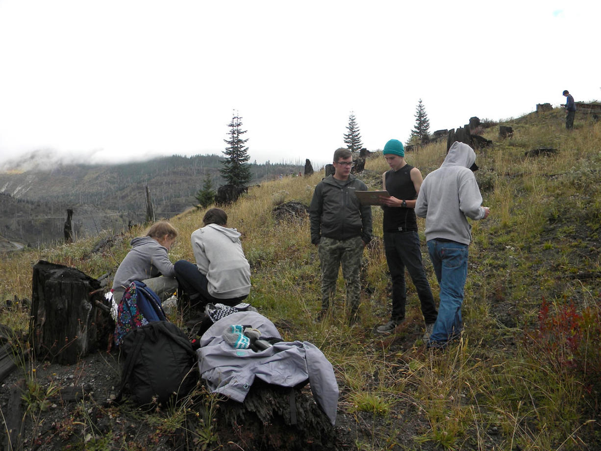 On a hilltop near the Miner's Car site at Mount St. Helens National Volcanic Monument, students from CASEE in Battle Ground prepare to conduct terrestrial sampling of ground cover, canopy and soils.