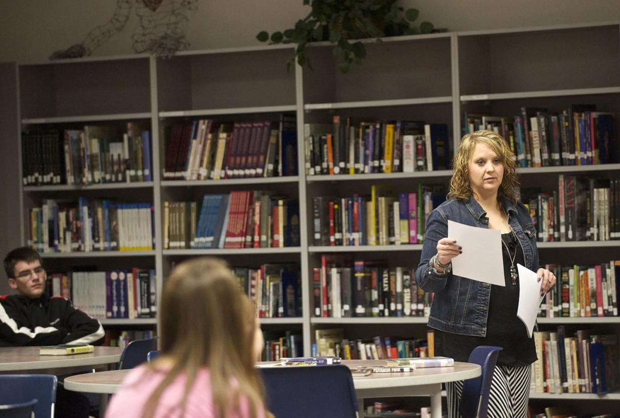"""Skyview High School teacher-librarian Traci Chun works with students Tuesday. """"It's like any other profession,"""" Chun said."""