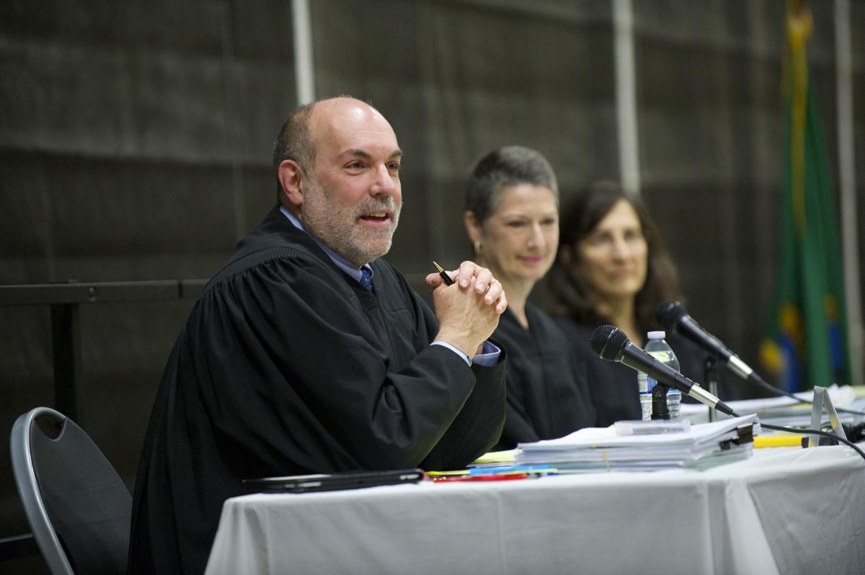 Washington State Court of Appeals Division II judges, from left, Rich Melnick, Jill Johanson and Lisa Worswick hear a local case at Hudson's Bay High School on Monday morning.