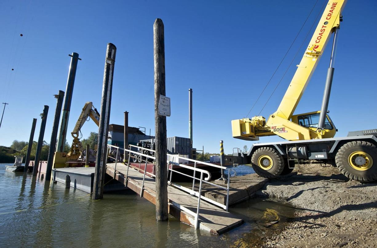 Dredging equipment sits ready to go Monday next to Lake River.