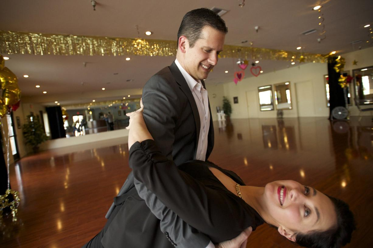 Arthur Murray dance instructor Phil Auer demonstrates his moves with fellow instructor Christina Mullen  in Vancouver.