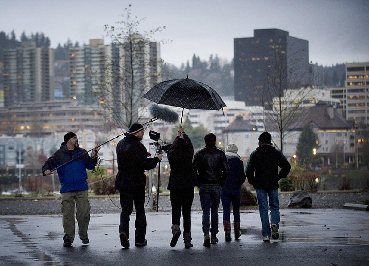 """The cast and crew of """"Black Eyed Kids"""" film near the east side of the Hawthorne bridge in Portland."""