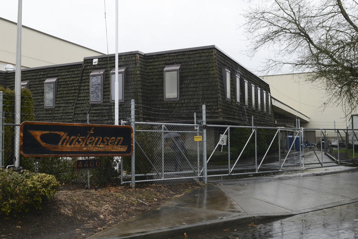 Workers arrived early Monday morning at Christensen Shipyards, the Vancouver-based builder of custom yachts, to find the gates locked. (Ariane Kunze/The Columbian)