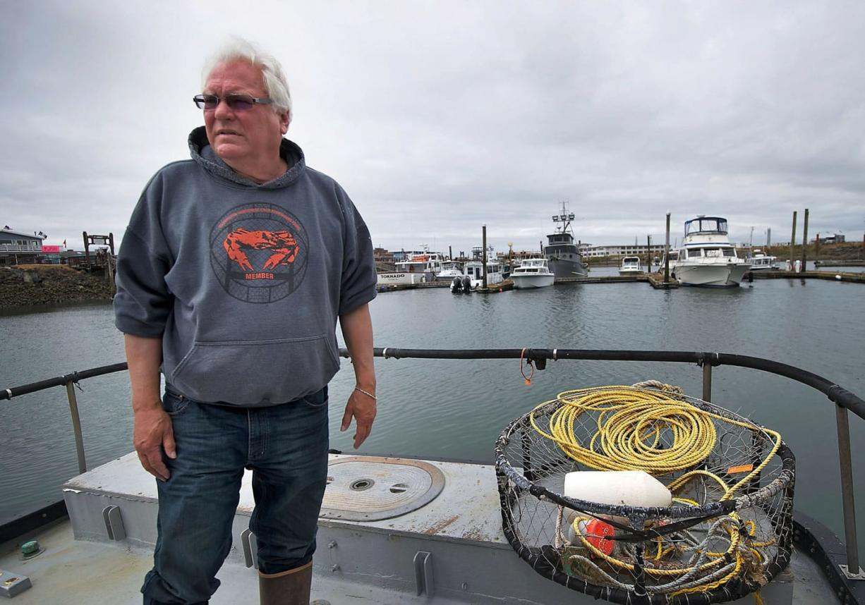 Crab fisherman Larry Thevik discusses his concerns regarding three proposed oil terminal sites in Grays Harbor County on his boat, the Midnight Star, while docked in Westport on Thursday, June 19, 2014. (Zachary Kaufman/The Columbian)