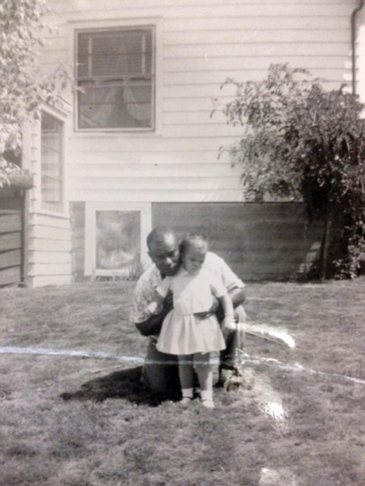 Marie Bruin kept this childhood photo of herself and her adoptive father on her desk at work.