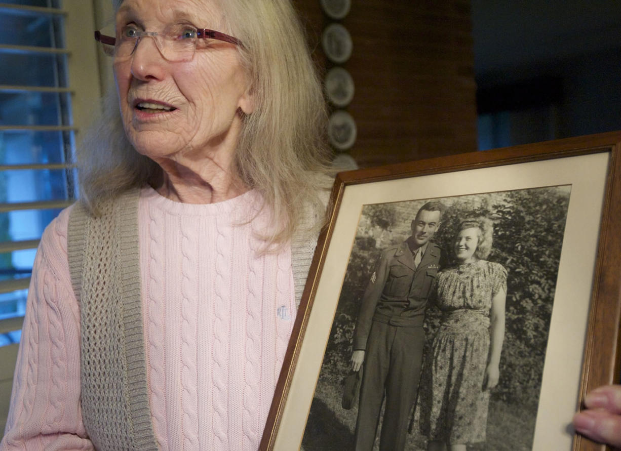 Gerda McMillan holds a 66-year-old old photograph of herself and her late husband taken during the American occupation of Germany following World War II.