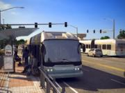 A Bus Rapid Transit vehicle stops on the side of East Fourth Plain Boulevard at Grand Boulevard in this artist's rendition of C-Tran's proposed system.