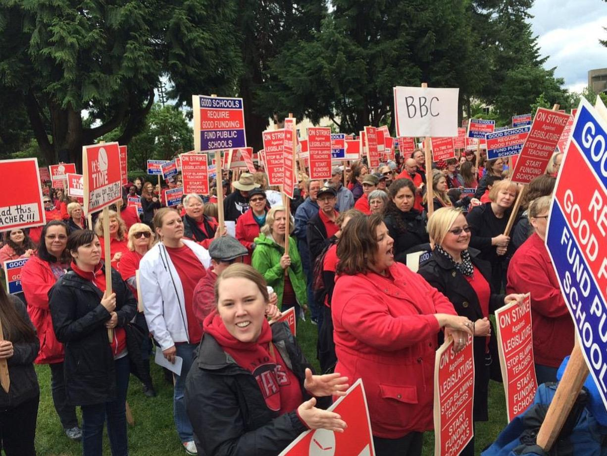 Teachers rally in Esther Short Park this morning in support of greater funding for schools.
