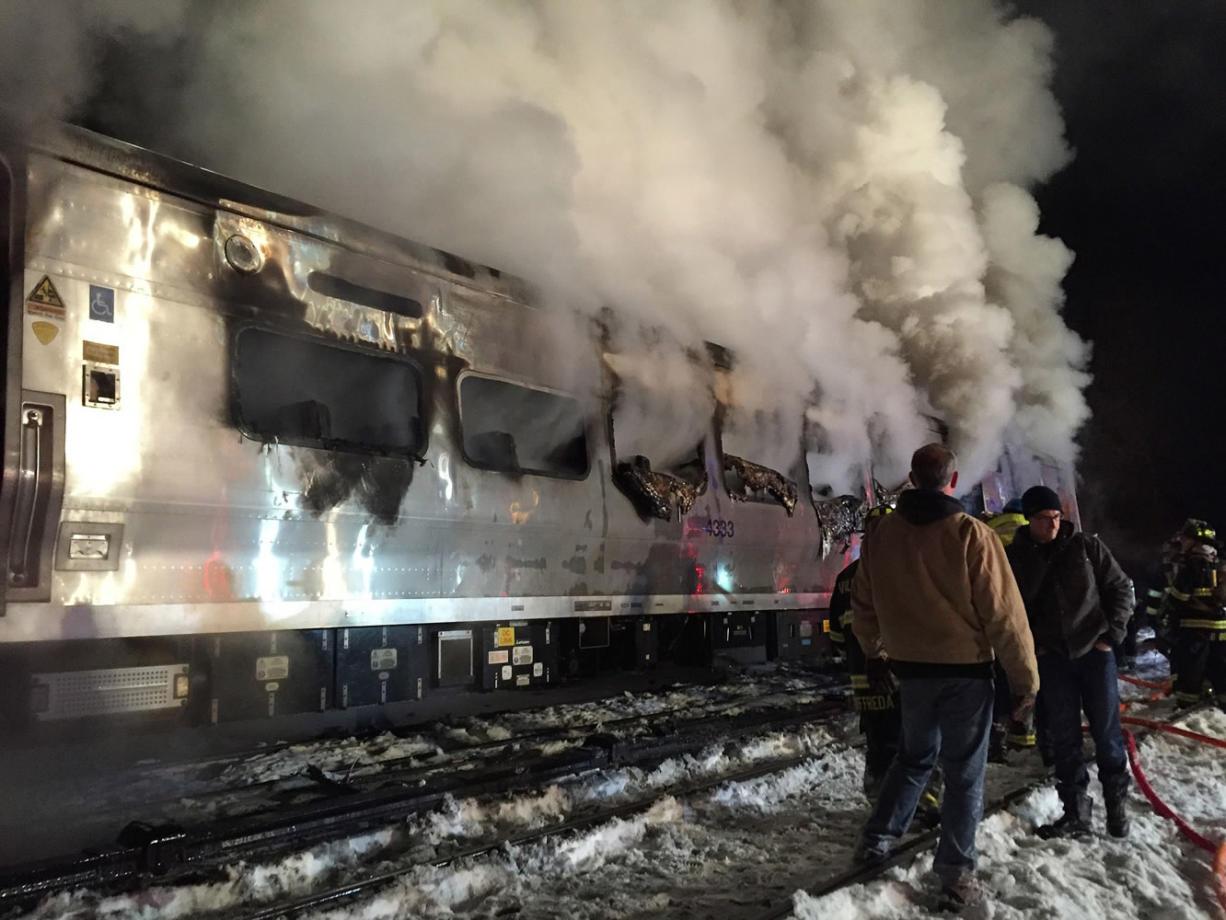 Commuter train crashes into SUV stuck on tracks, killing 7