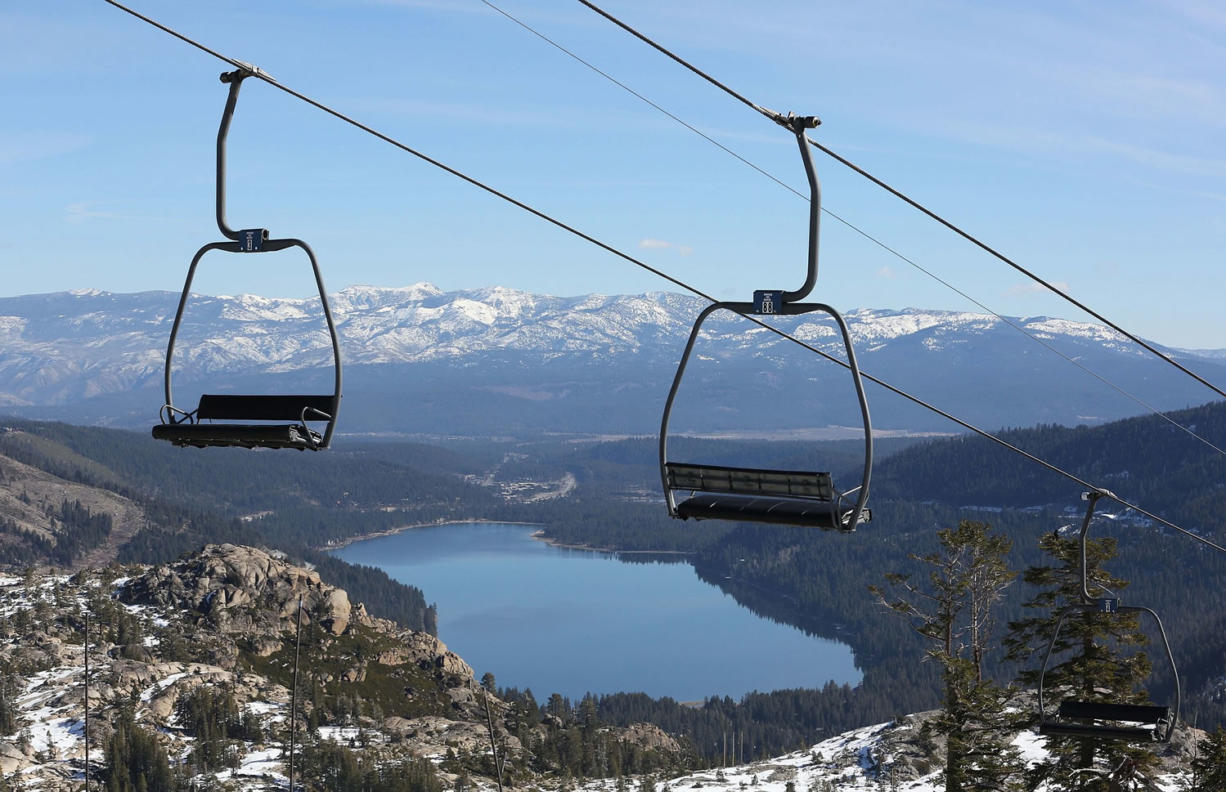Associated Press files A ski lift overlooking Donner Lake and slopes of visible rock sits idle Jan. 28 at Donner Ski Ranch in Norden, Calif.
