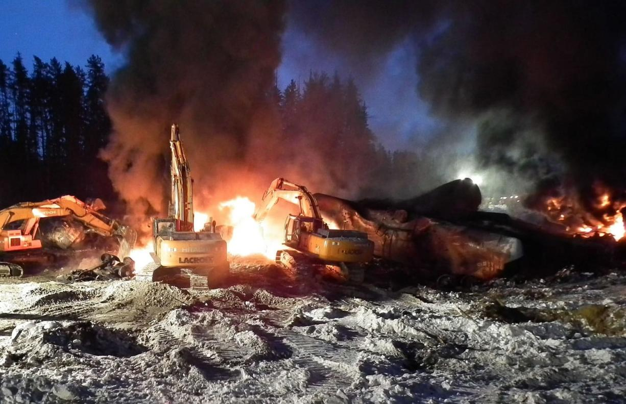 Transportation Safety Board of Canada files Workers fight a fire Feb. 16 after a crude oil train derailment south of south of Timmins, Ontario. The train derailment this month suggests new safety requirements for tank cars carrying flammable liquids are inadequate, Canada's transportation safety board announced Monday.