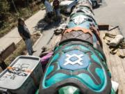 A truck carrying a totem pole carved by the Lummi Nation stops outside Vancouver, B.C., Friday, Aug. 21, the totem's first stop on a journey from Canada through the Pacific Northwest to Montana.