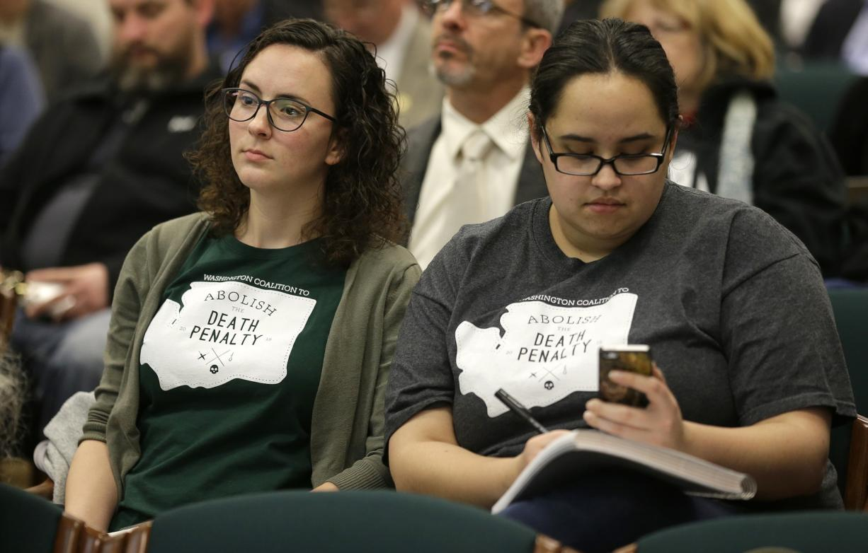Danielle Fulfs, left, and Xochitl Maykovich , right, both with the Washington Coalition to Abolish the Death Penalty, listen and take notes during a hearing session of House Judiciary Committee, Wednesday, Feb.