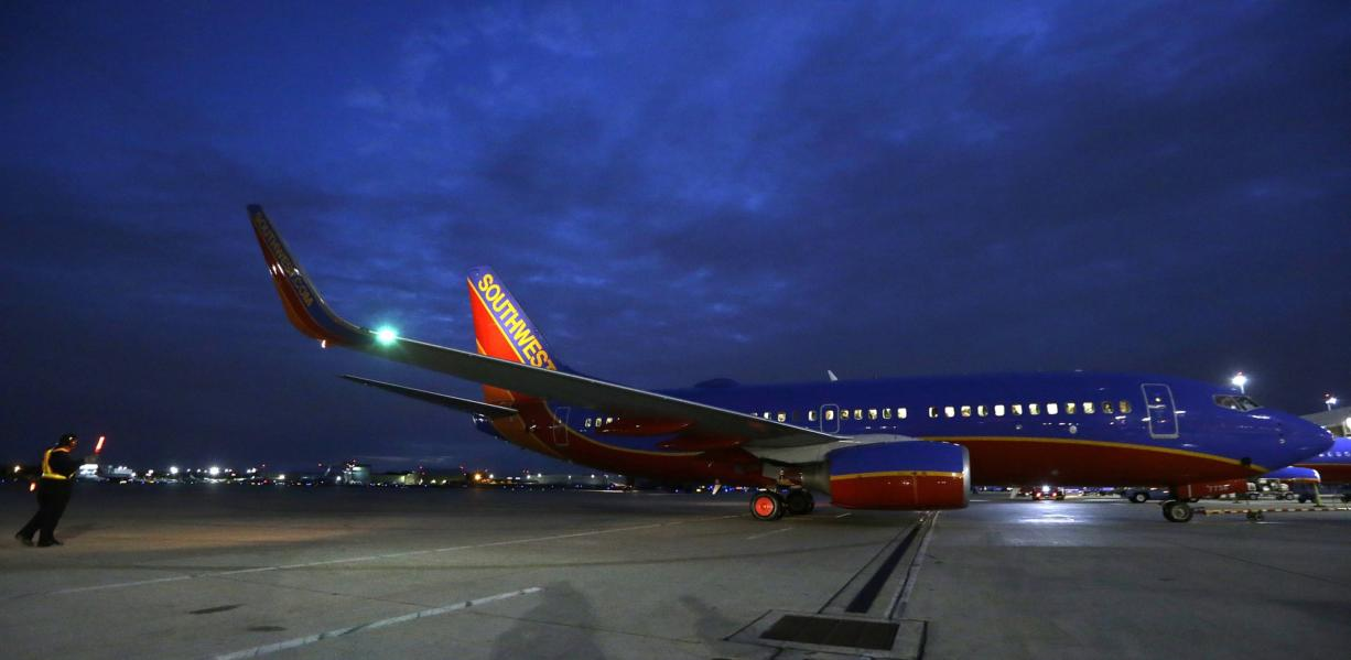 A Southwest Airlines originator flight pulls from the gate for departure from Love Field in Dallas.
