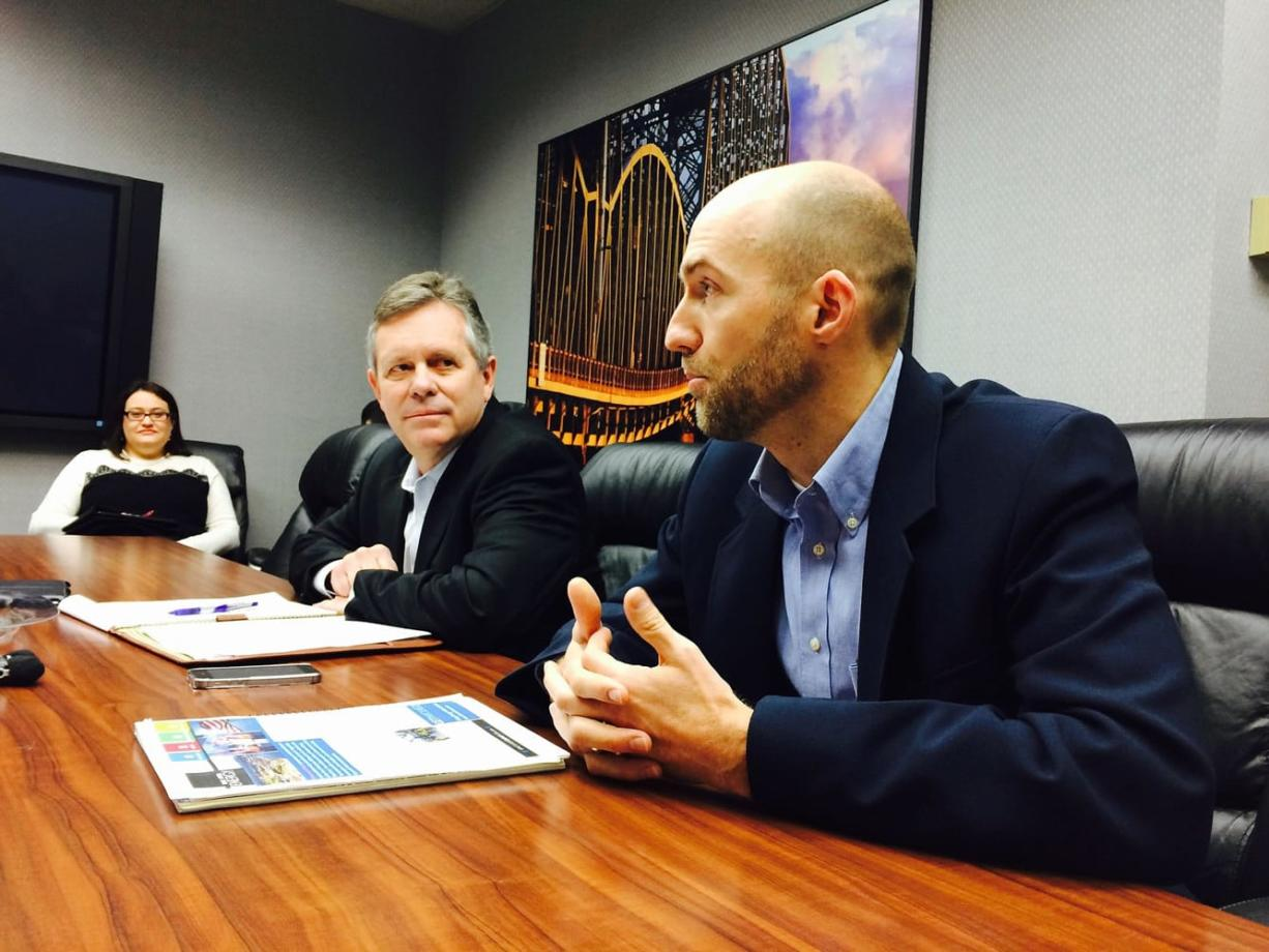 From left, Jennifer Minx, a spokeswoman for Tesoro, Dan Riley, vice president of government affairs for Tesoro, and Jared Larrabee, general manager of Vancouver Energy, visit The Columbian's editorial board.