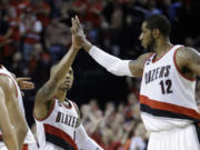 LaMarcus Aldridge, right, is handing off being the face of the Portland Trail Blazers to Damian Lillard, left.