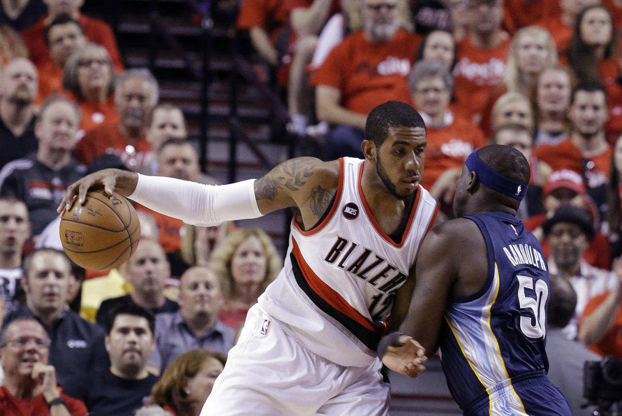 Portland Trail Blazers forward LaMarcus Aldridge, left, works the ball in against Memphis Grizzlies forward Zach Randolph during the first half of Game 4 in Portland on Monday, April 27, 2015.