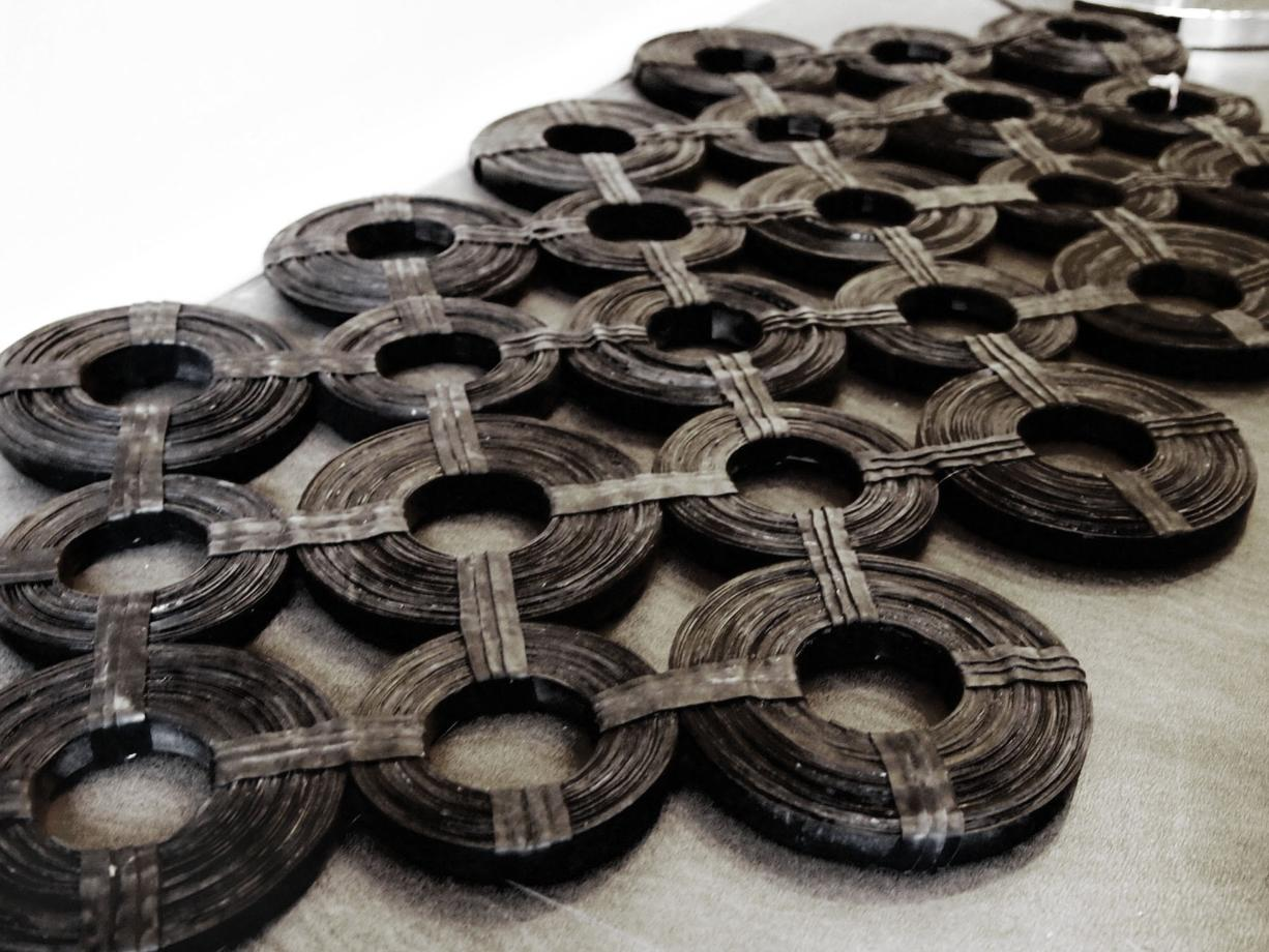Solo Home Design Inner tubes are manipulated into clever recycled doormats at Solo Home Design.
