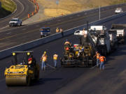 Workers do paving work in 2006 on Interstate 5 at Milepost 7, just south of the 134th Street offramp.
