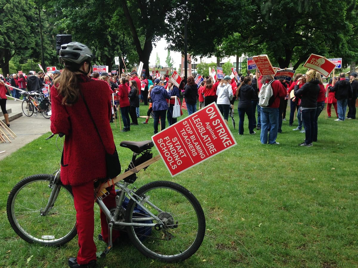 Teachers stage a rally at Esther Short Park today to call attention to their demands for more education funding.